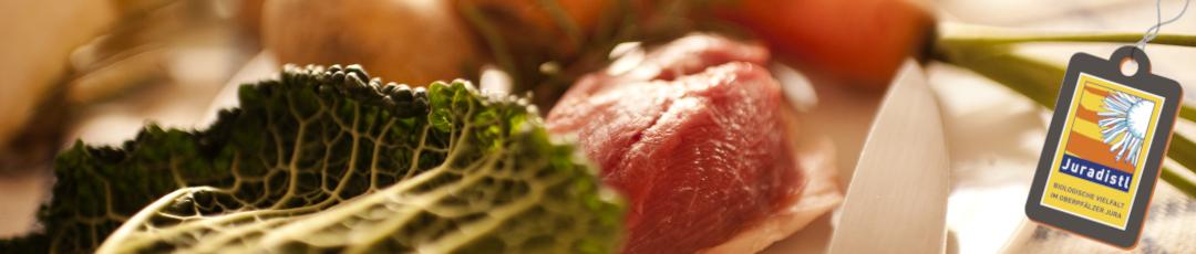 Fleisch, Gemüse und Messer, Lust auf Kochen mit Regionalprodukten